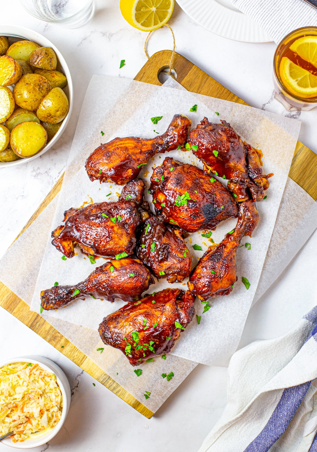 Overhead photo of BBQ Chicken on parchment paper over cutting board