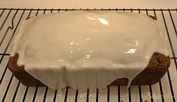 While bread is cooling, make the vanilla glaze. Melt the butter in microwave safe bowl, add in the vanilla, powdered sugar and water. Stir to combine. When bread is completely cool, pour glaze over the top of the bread and let it run down the sides, make sure you have a pan underneath to catch any excess glaze.