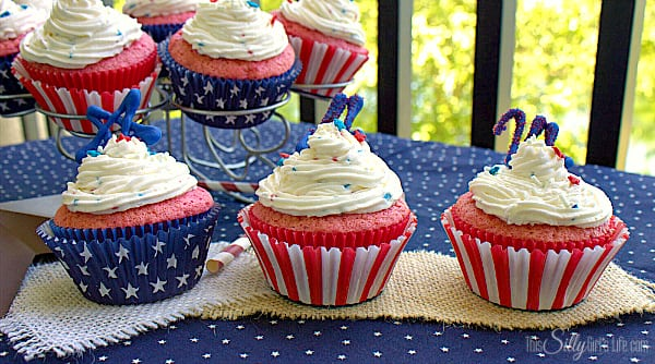 Patriotic Strawberry Cupcakes with Funfetti Frosting, light and fluffy strawberry cupcakes topped with red, white and blue funfetti vanilla buttercream!