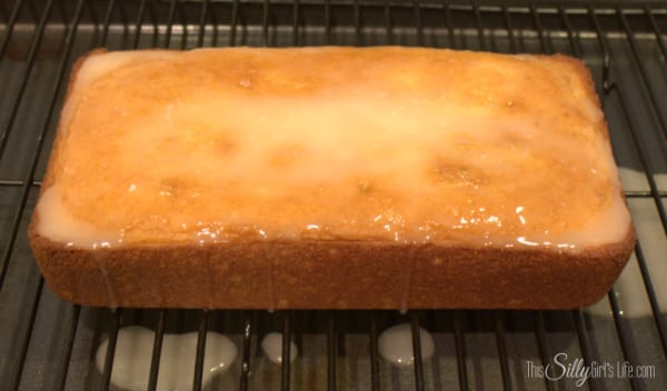While cake is cooling, mix the remaining ingredients together (except for the additional powdered sugar for garnish). Pour evenly on top of cake.