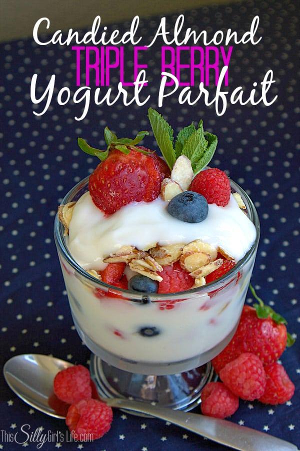 Candied Almond Triple Berry Yogurt Parfait, vanilla yogurt layered with fresh berries and homemade candied almonds.
