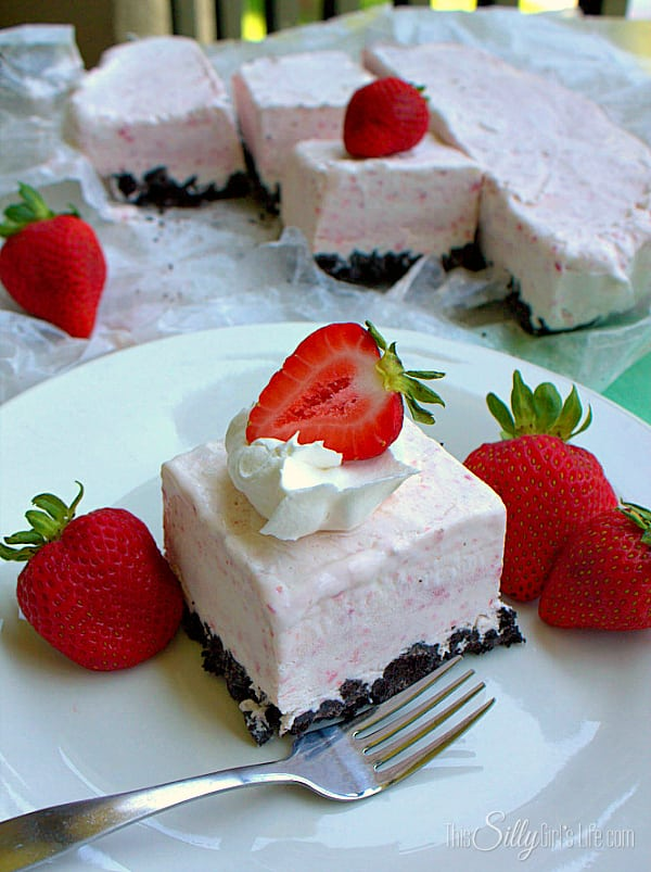 Chocolate Covered Strawberry Icebox Bars, fresh strawberry puree mixed with cream cheese, poured over crushed oreos and frozen for a perfect summer dessert!