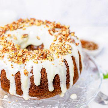 Square image of bundt cake finished on cake stand