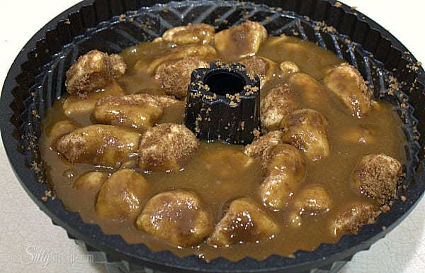 In a small sauce pan, place the butter and remaining brown sugar for the glaze. Whisk together and let come to a boil. As soon as it is at a boil, pour over the biscuits in the bundt pan.