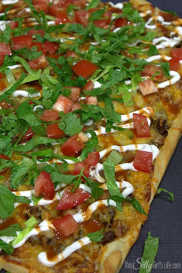 Easy Taco Pizza, two favorites combine to make a delicious, easy meal that's ready in 30 minutes or less! - https://ThisSillyGirlsLife.com