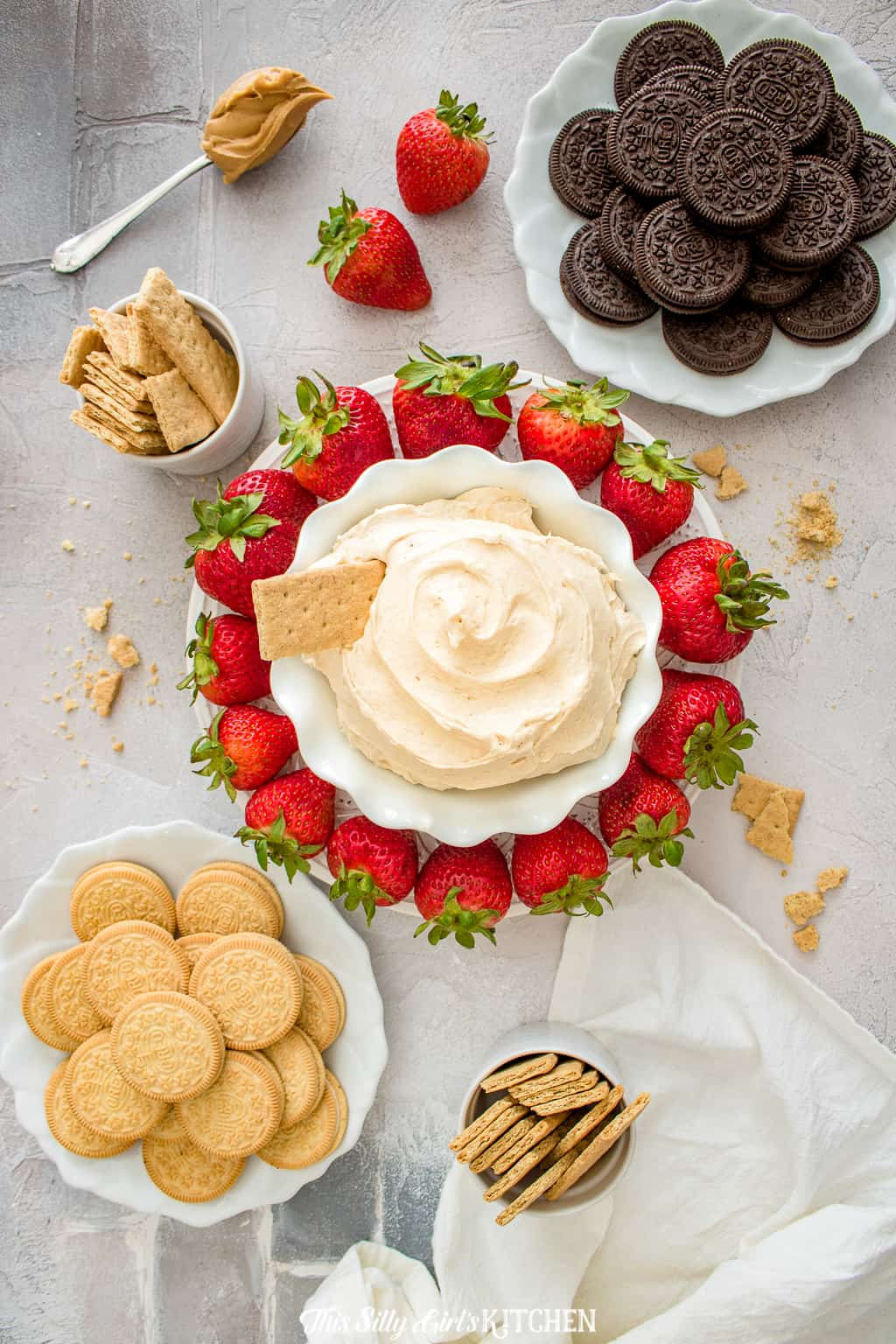 Fluffernutter Dip surrounded by various dipping items overhead photo