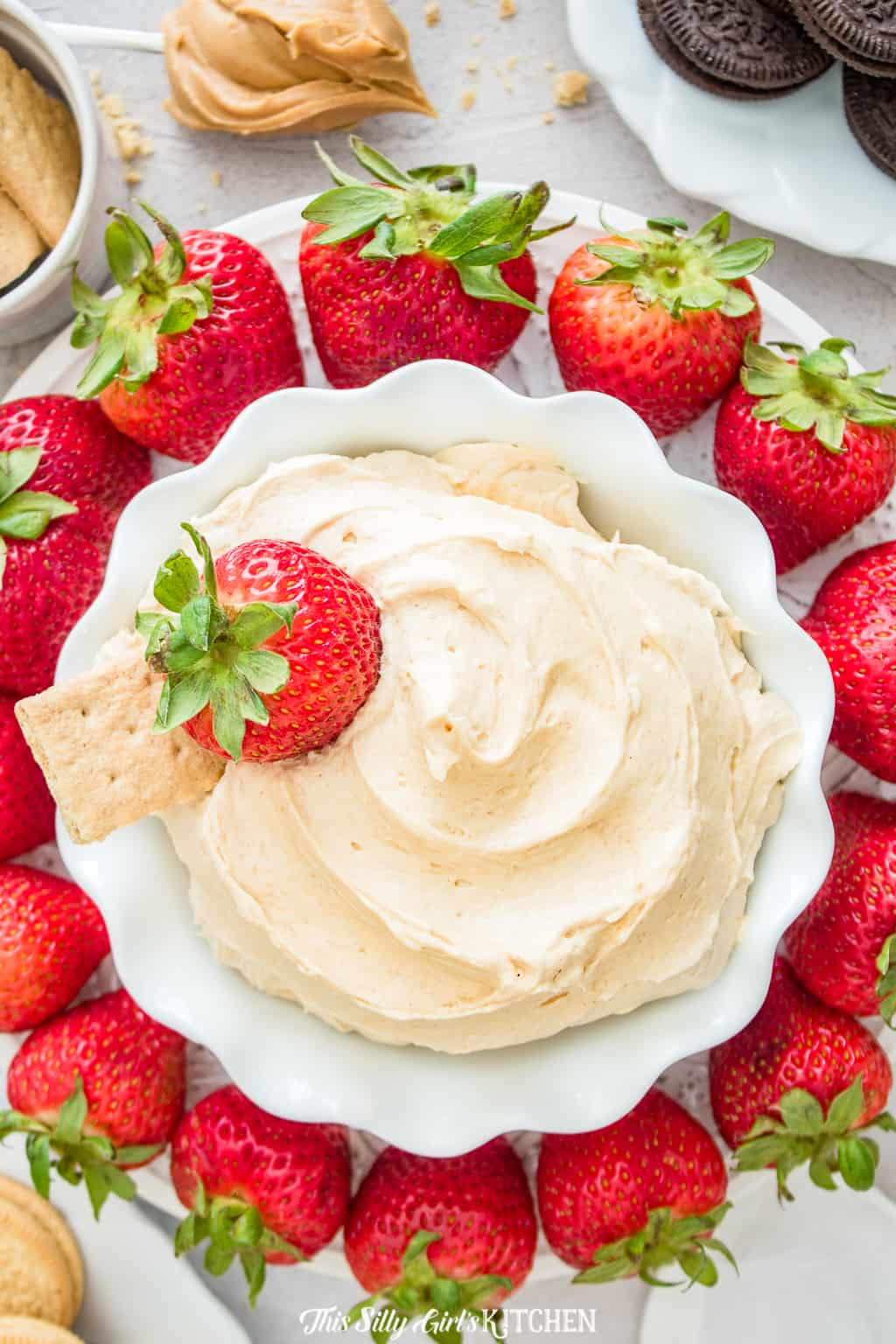 Fluffernutter Dip overhead in bowl with strawberries