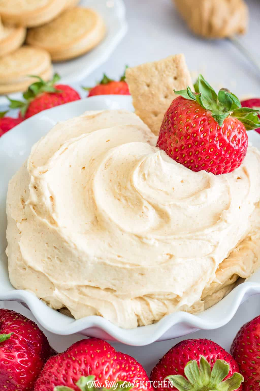 Close up of Fluffernutter Dip in bowl with strawberry