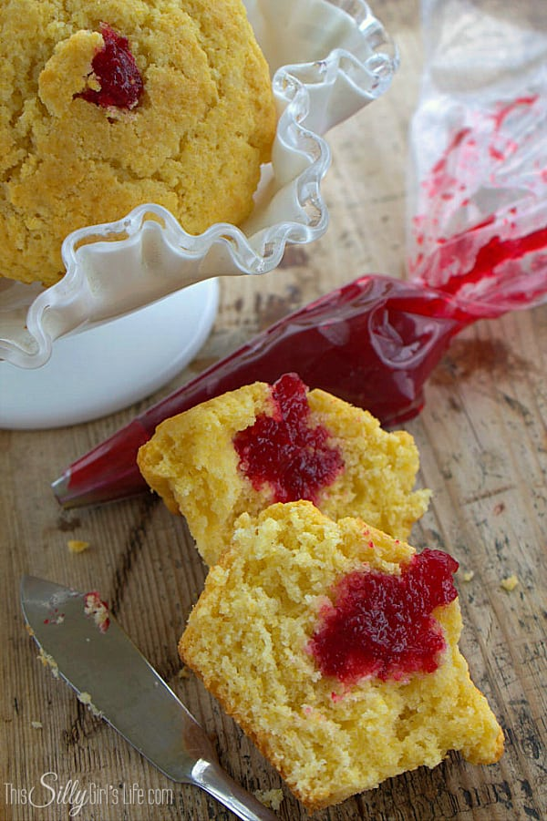 Cranberry Corn Muffins, homemade cornbread muffins stuffed with cranberry jam, a new holiday staple! - ThisSillyGirlsLife.com