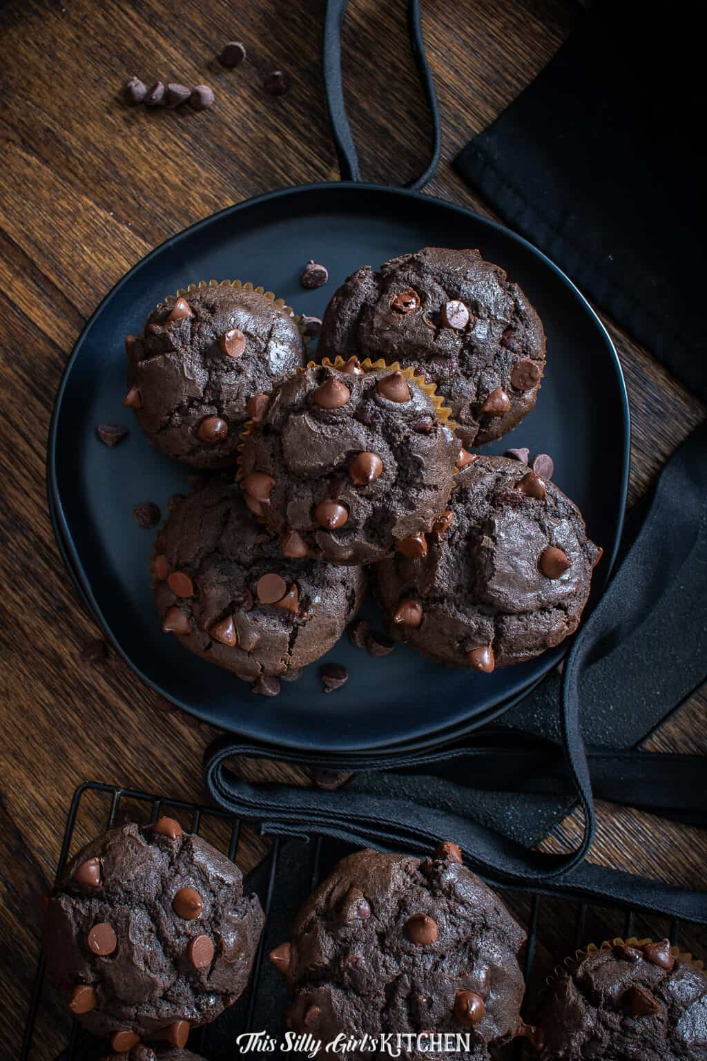 Chocolate Chip Muffins on black plate overhead