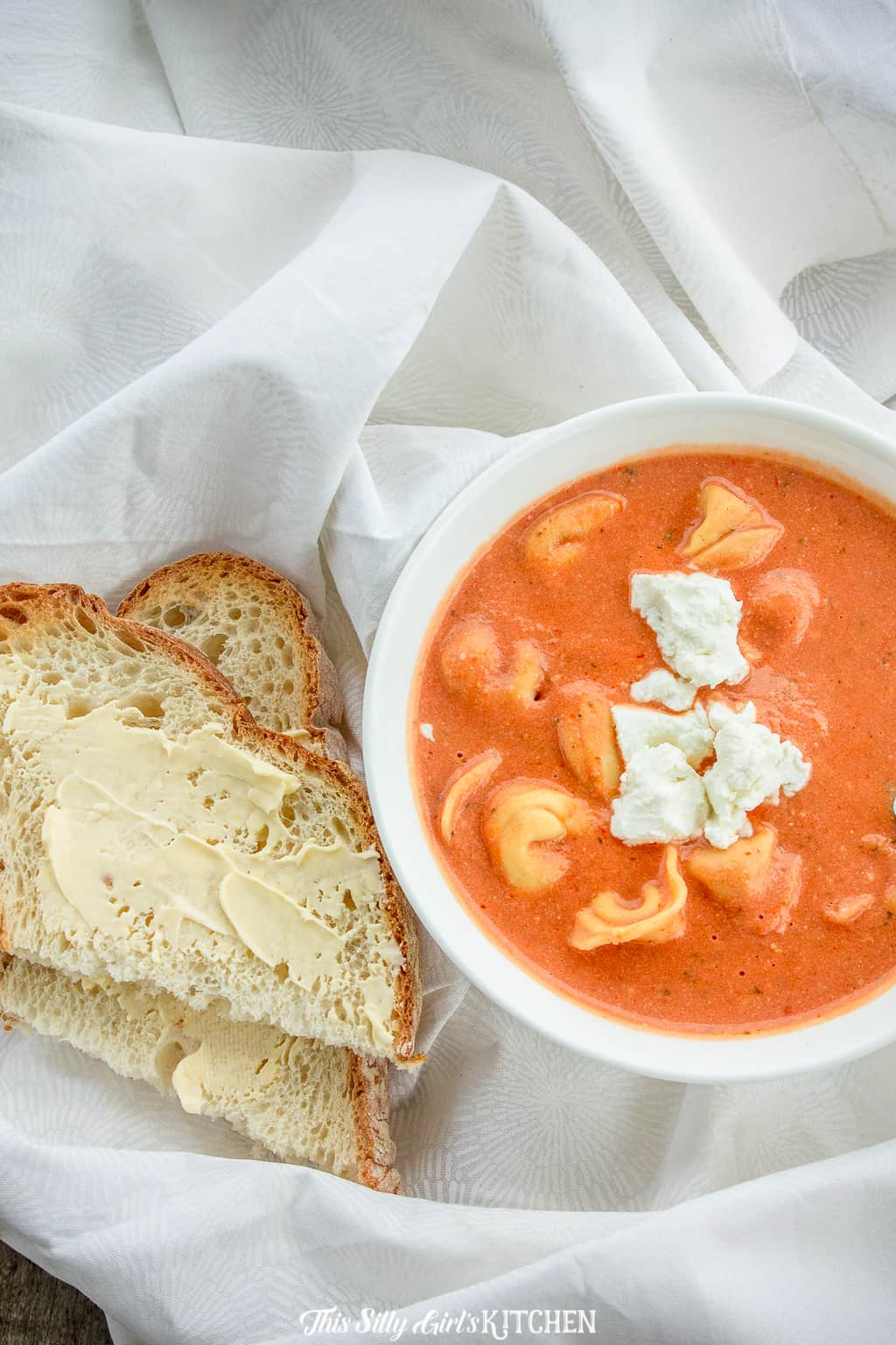 Overhead of soup with cheese and bread