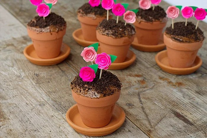 Flowerpot Cupcakes, chocolate devil's food cake baked in mini terracotta flower pots, topped with frosting, Oreo crumbs and pretty paper flowers to mimic flowerpots! - ThisSillyGirlsLife.com #FlowerpotCupcakes