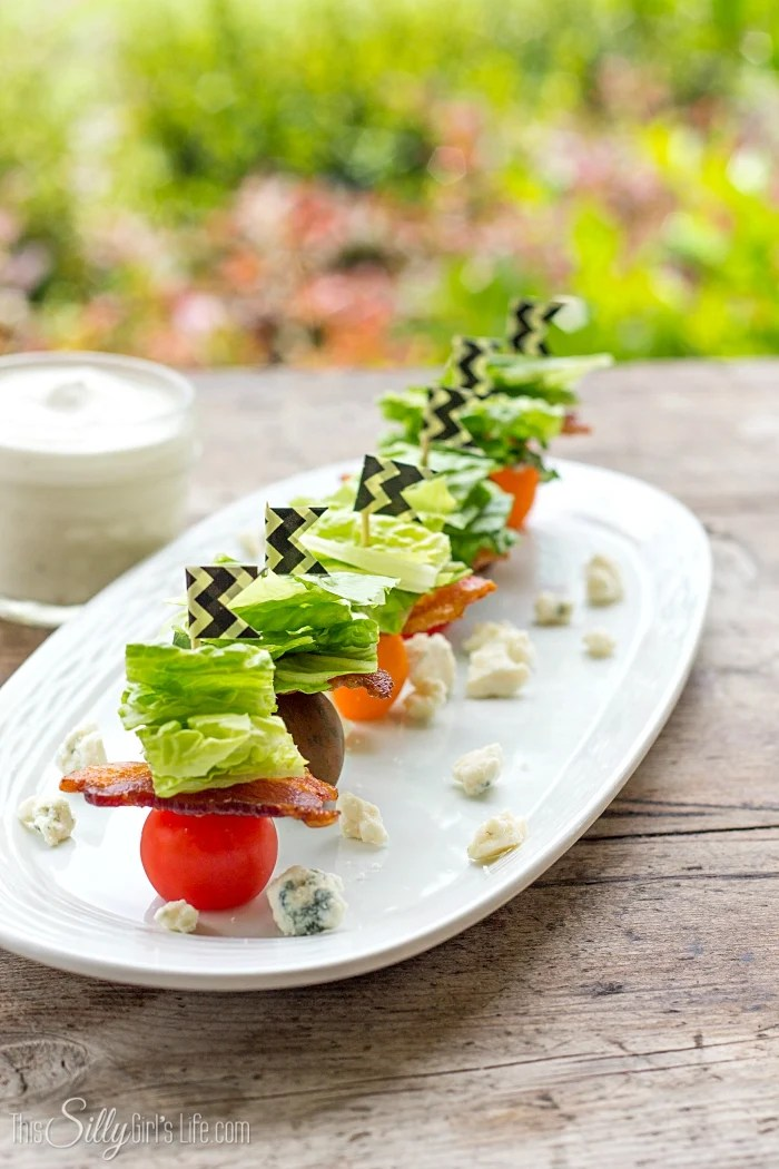 Wedge Salad Bites, the classic salad in bite size, with homemade blue cheese dressing! - ThisSillyGirlsLife.com #wedgesalad #bluecheesedressing #appetizer