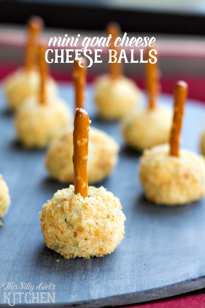 Mini Goat Cheese Cheese Balls, herbs, goat cheese and pretzels make for a fun and functional appetizer! Plus a secret ingredient! from ThisSillyGirlsLife.com #cheeseball