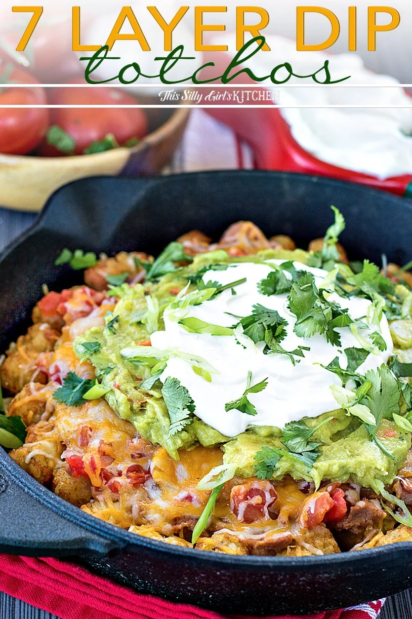 7 Layer Dip Totchos, taking classic 7 layer dip and tater tots to next level deliciousness! #recipe from thissillygirlskitchen.com #totchos #nachos #sevenlayerdip #7layerdip #totchosnachos