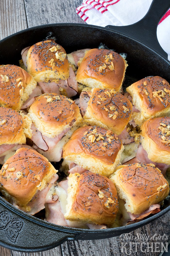 Overhead of baked Ham and Swiss Sliders in cast iron pan