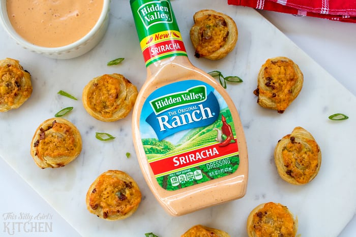 Spicy Cheddar Bacon Ranch Pinwheels, crispy puffed pastry bites, made with Sriracha Ranch for a little kick! from ThisSillyGirlsLife.com @HVRanch #RanchEverything Sponsored by Hidden Valley