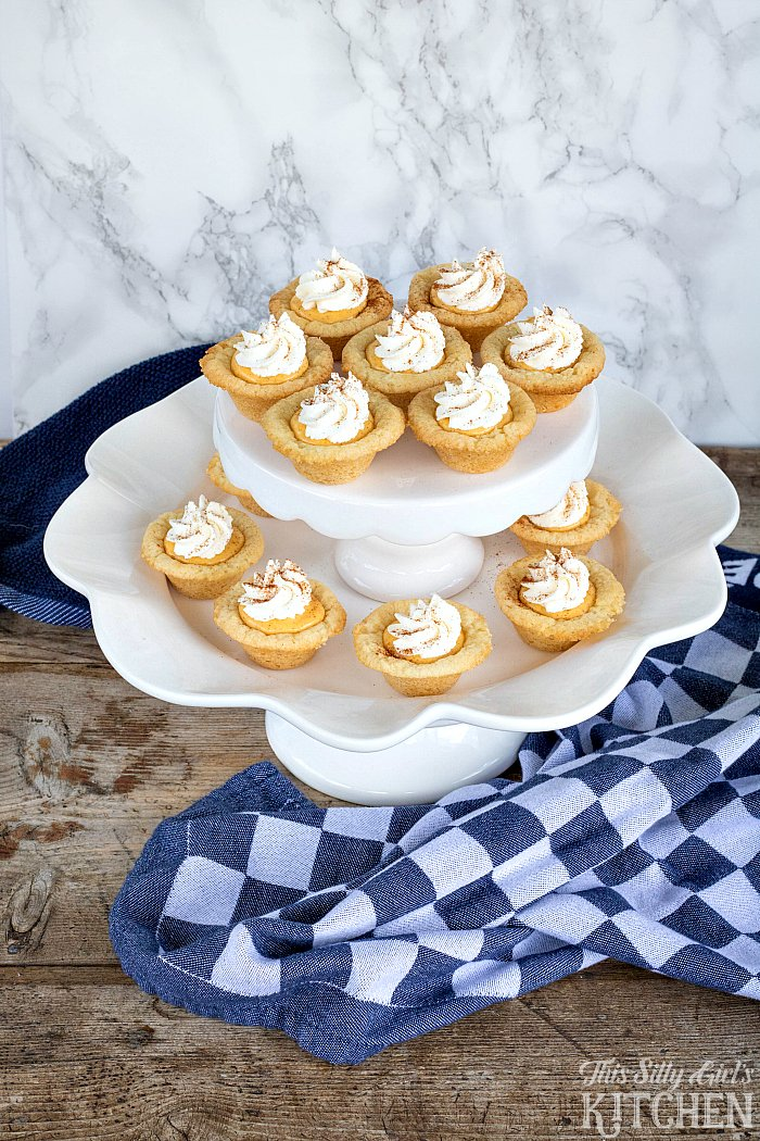 Pumpkin Cream Sugar Cookie Cups, sweetened cream cheese flavored with pumpkin and cinnamon in sugar cookie cups, garnished with fresh whipped cream! from ThisSillyGirlsLife.com