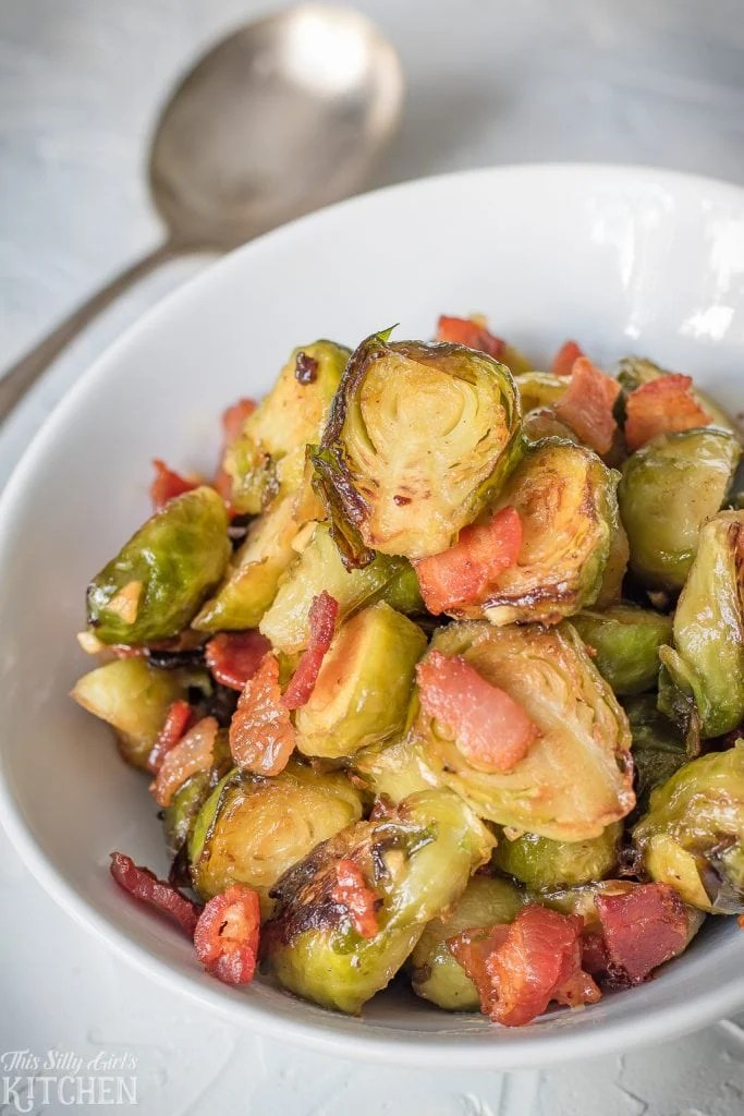Roasted Brussel Sprouts with Bacon in white dish with spoon