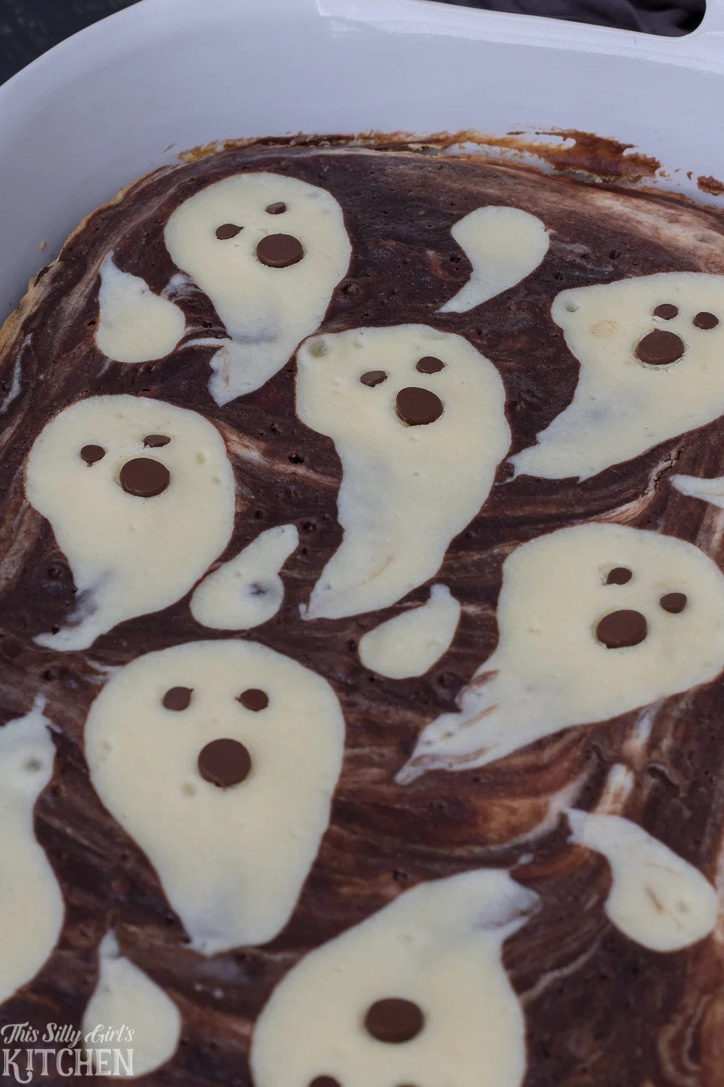 Finished close up Ghost Cheesecake Brownies in baking pan.