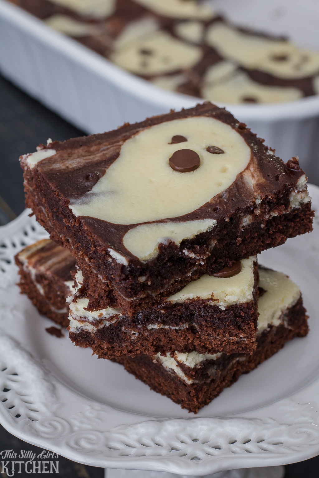 Close up of stacked brownies on white plate showing ghosts.