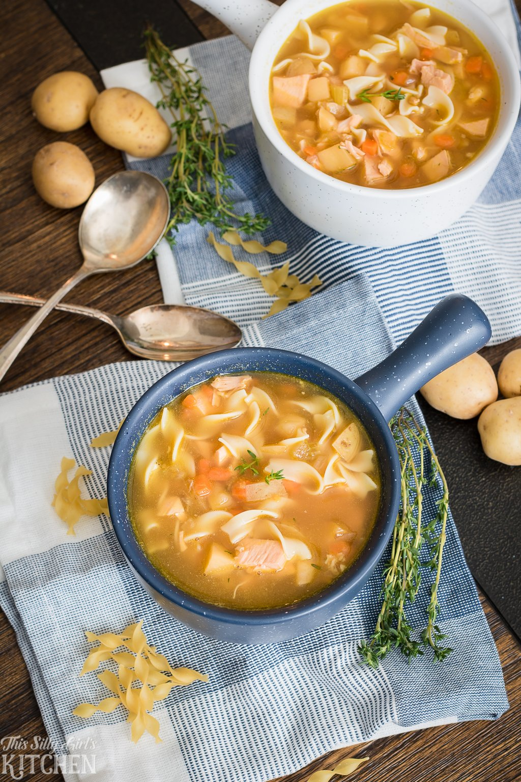 Rotisserie Chicken Noodle Soup, ready in 30 minutes and bursting with flavor! Recipe from ThisSillyGirlsKitchen.com #chickennoodlesoup #soup #rotisseriechicken