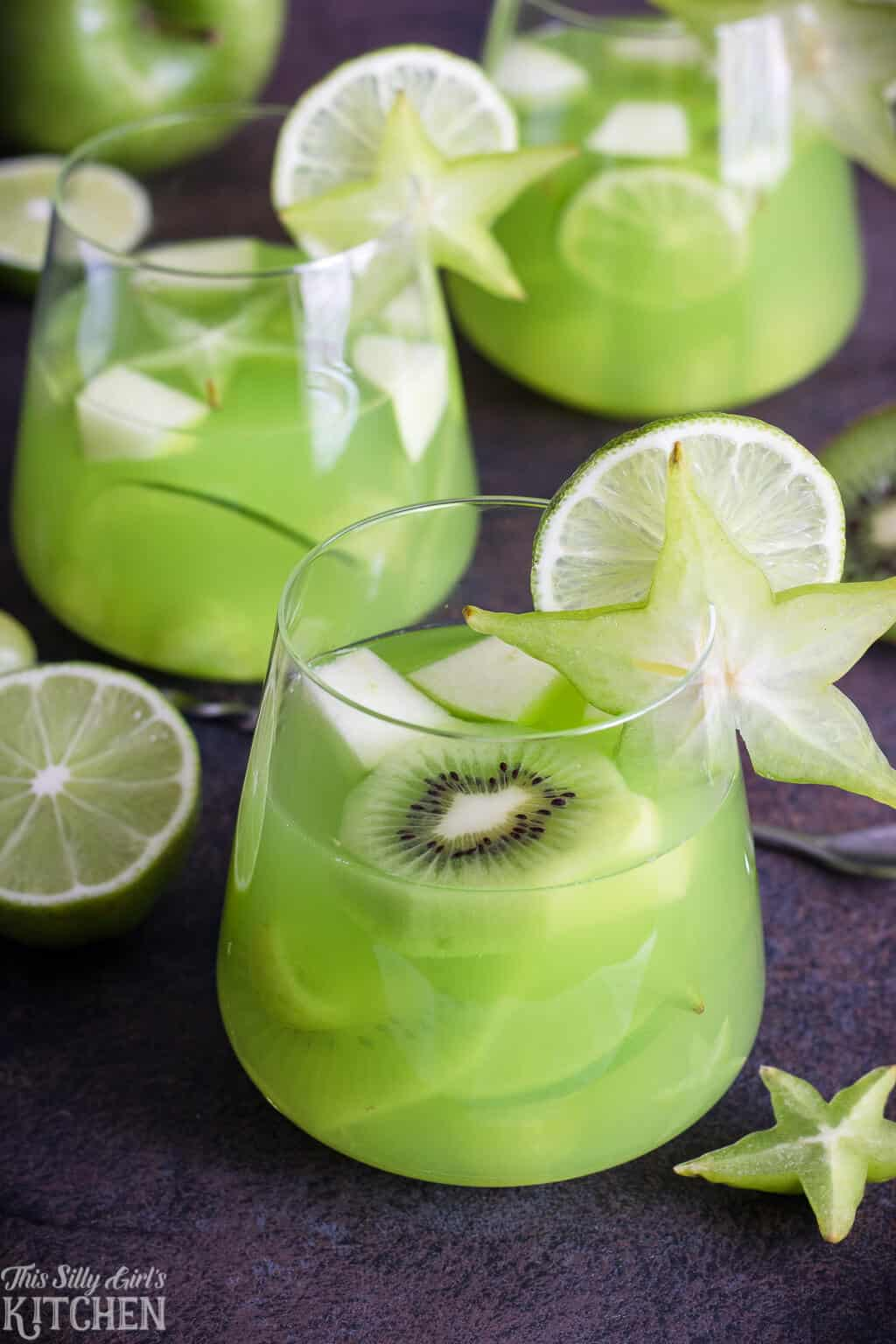Green Party Punch, an easy and refreshing punch to serve at any party! #Recipe from ThisSillyGirlsKitchen.com #partypunch #punch #green #fruitpunch