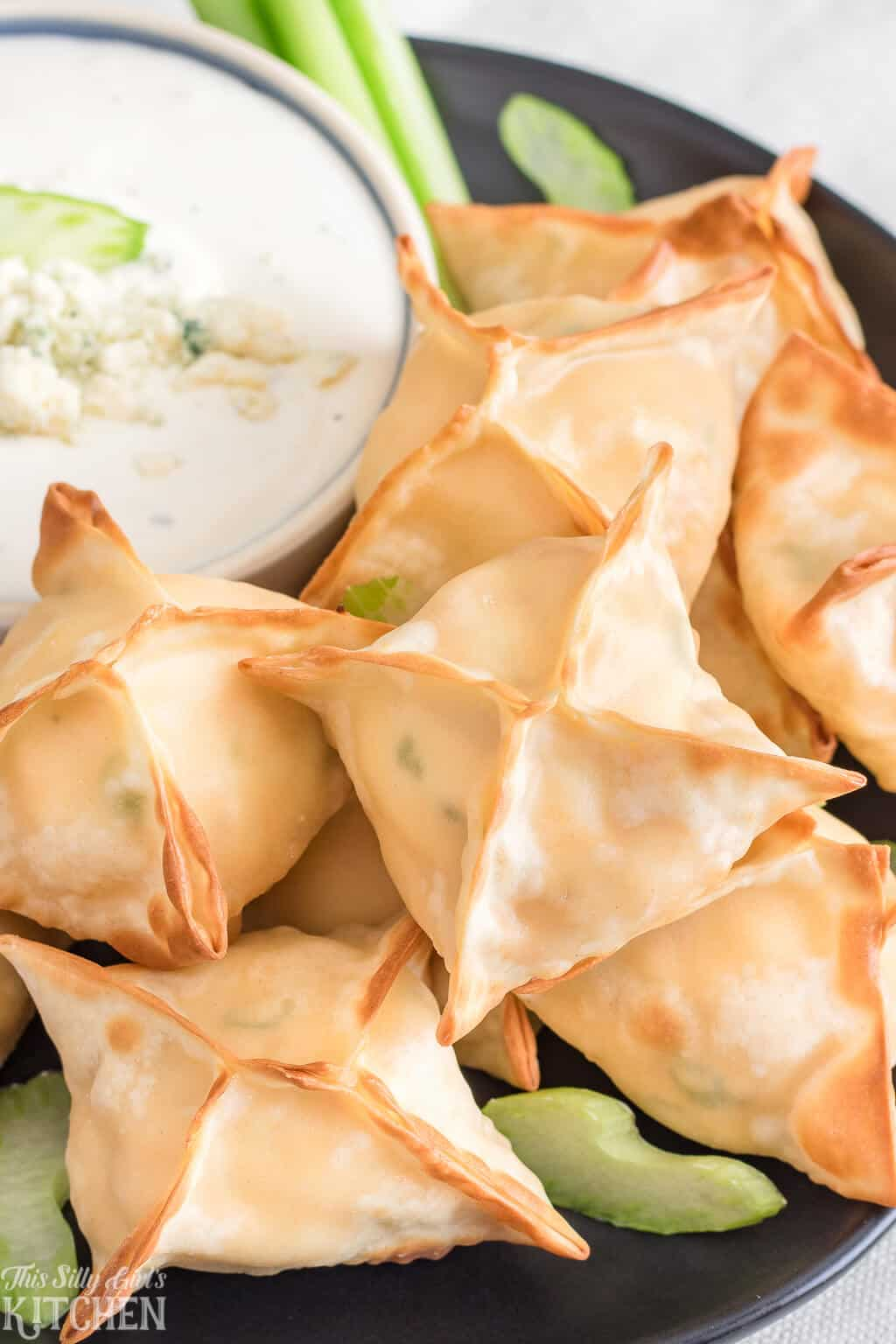 Buffalo Chicken Wontons, only 6 ingredients and ready in 15 minutes, perfect for game day! #Recipe from ThisSillyGirlsKitchen.com #buffalochicken #wontons #airfryer