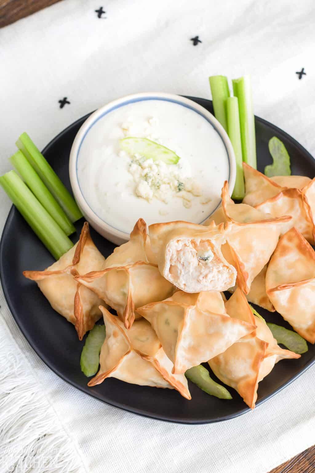 The Best Buffalo Chicken Wontons, only 6 ingredients and ready in 15 minutes, perfect for game day! #Recipe from ThisSillyGirlsKitchen.com #buffalochicken #wontons #airfryer