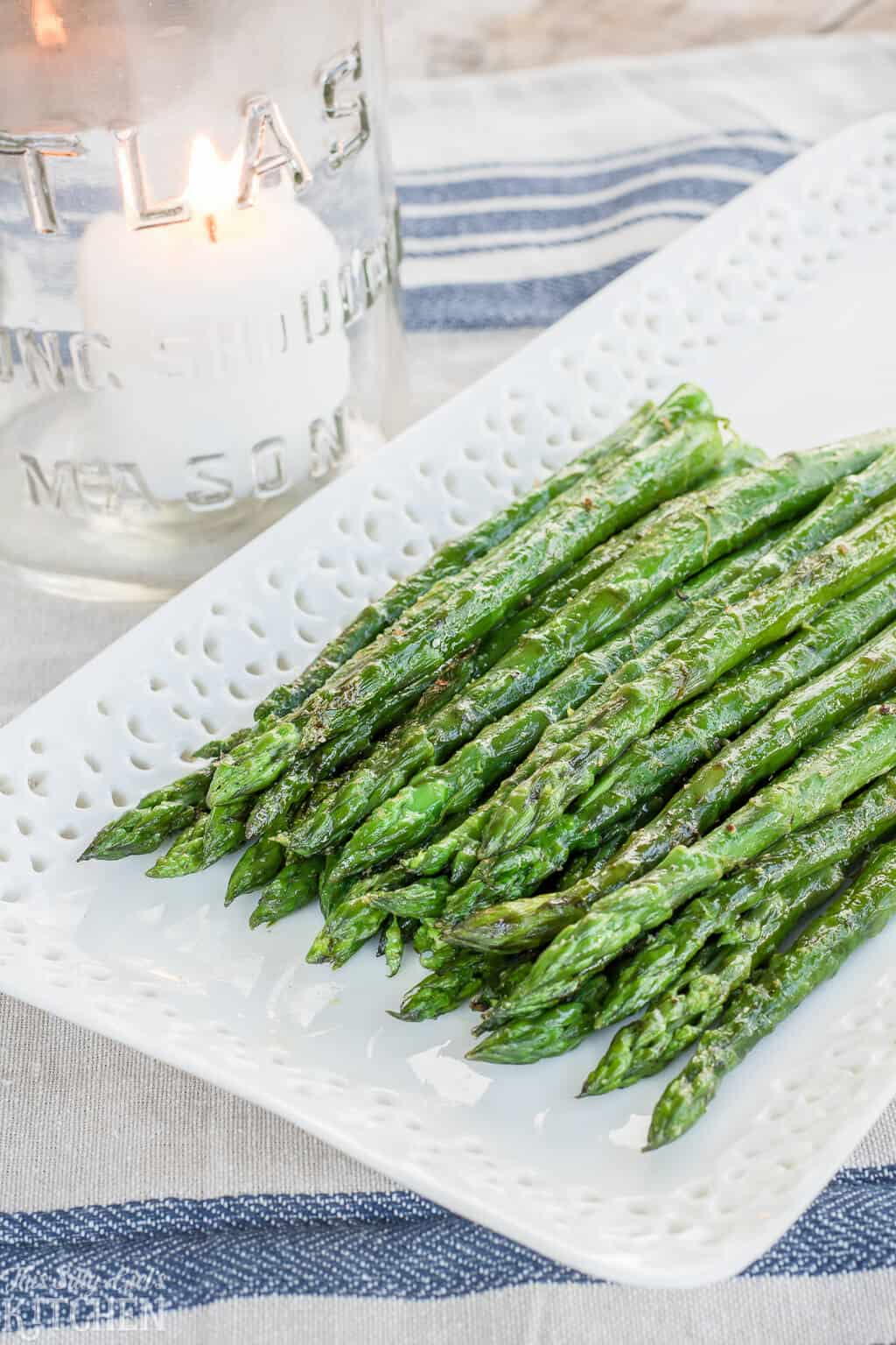 The Best Grilled Asparagus Recipe, made with 5 simple ingredients and ready in under 15 minutes! #Recipe from ThisSillyGirlsKitchen.com #asparagus #grilledasparagus
