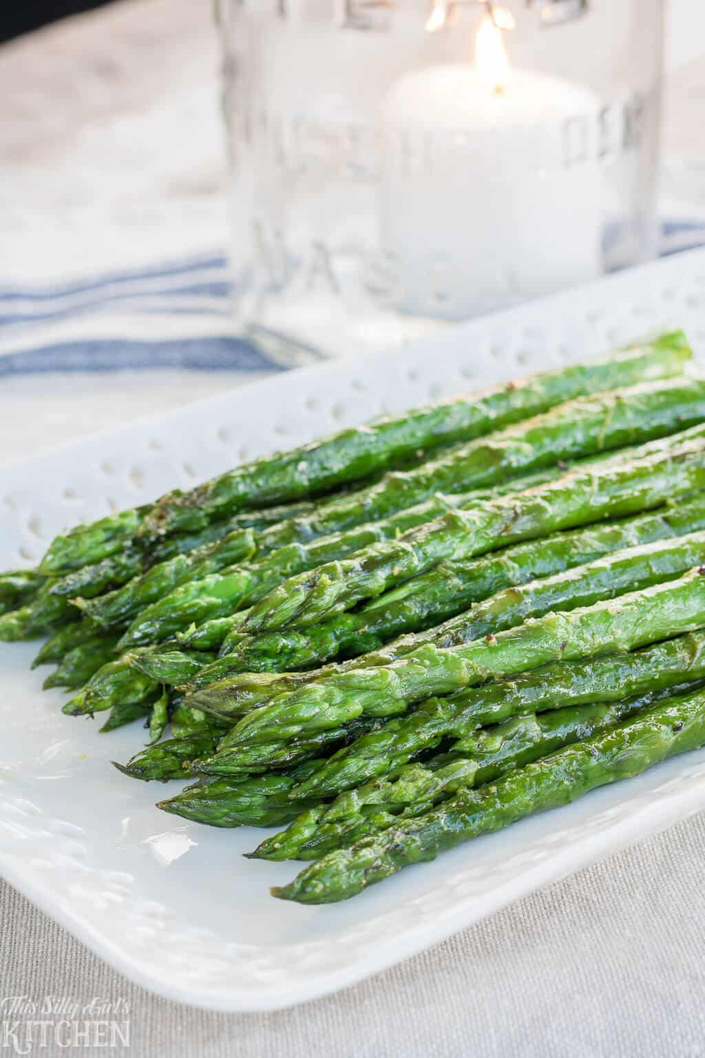 Easy Grilled Asparagus Recipe, made with 5 simple ingredients and ready in under 15 minutes! #Recipe from ThisSillyGirlsKitchen.com #asparagus #grilledasparagus