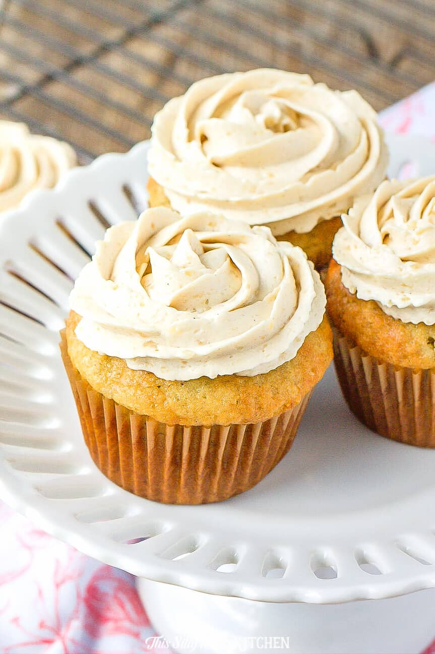Banana Cupcakes, light, moist cupcakes topped with THE BEST brown sugar frosting. #recipe from thissillygirlskitchen.com #bananacupcakes #brownsugarfrosting #cupcakefrosting #cupcakes