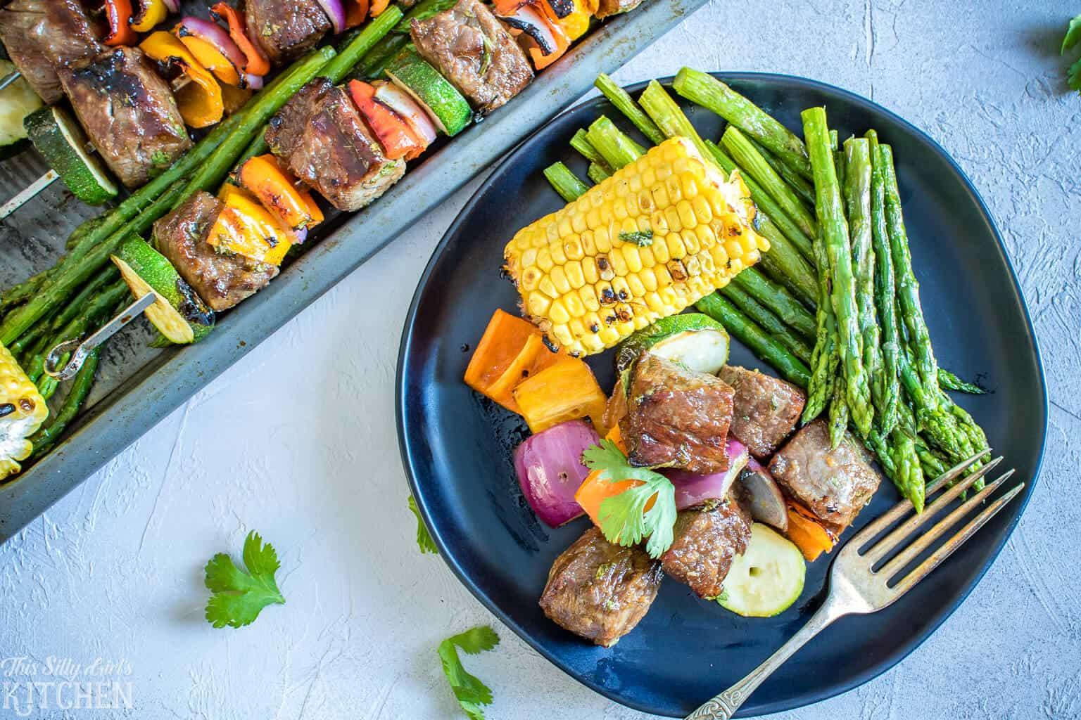 Carne Asada Steak Kabobs, NY strip marinated in the BEST marinade with lots of yummy veggies! #Recipe from ThisSillyGirlsKitchen.com #kabobs #steakkabob #carneasada