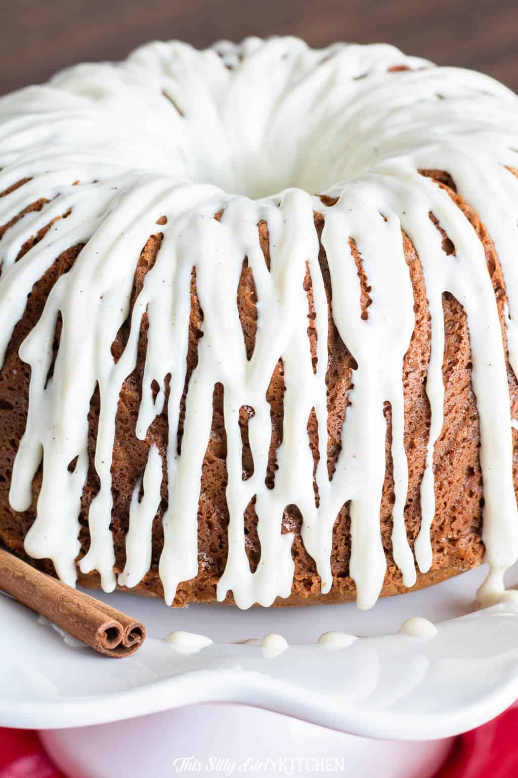 Close up of glaze dripping down sides of bundt cake