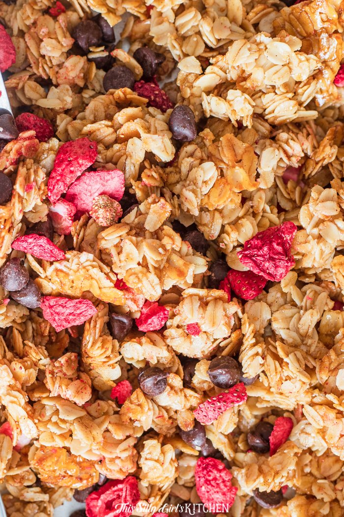 This homemade granola is extra special, the addition of freeze dried strawberries and dark chocolate chips really sets it apart. #recipe from thissillygirlskitchen.com #granola #homemadegranola #breakfast #strawberrygranola #chocolategranola