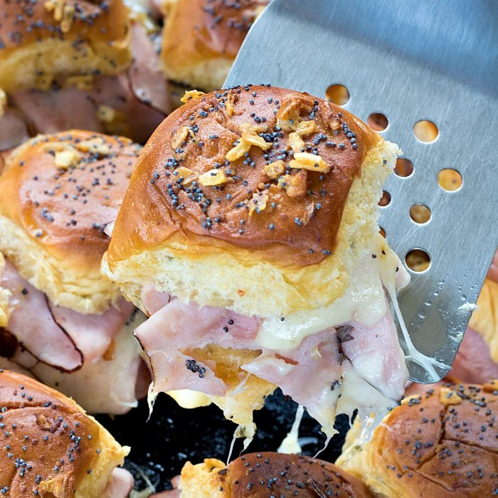 Close up of Ham and Swiss Slider lifted up with spatula square image
