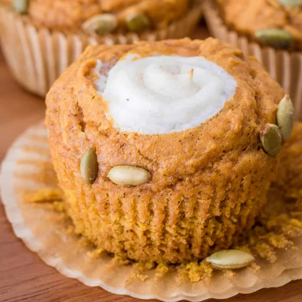 Square image of muffin with liner pulled down.