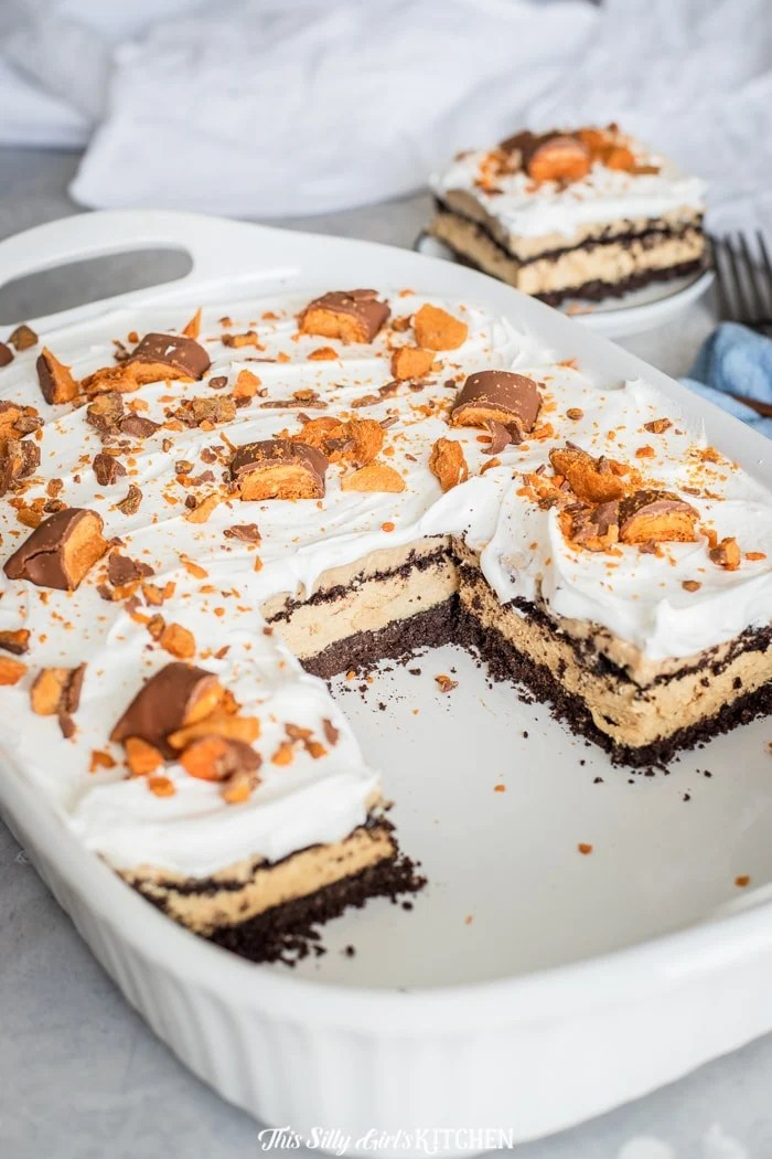 Peanut Butter Lasagna in baking dish with slices removed