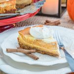 Pumpkin cheesecake on plate with cinnamon sticks square image