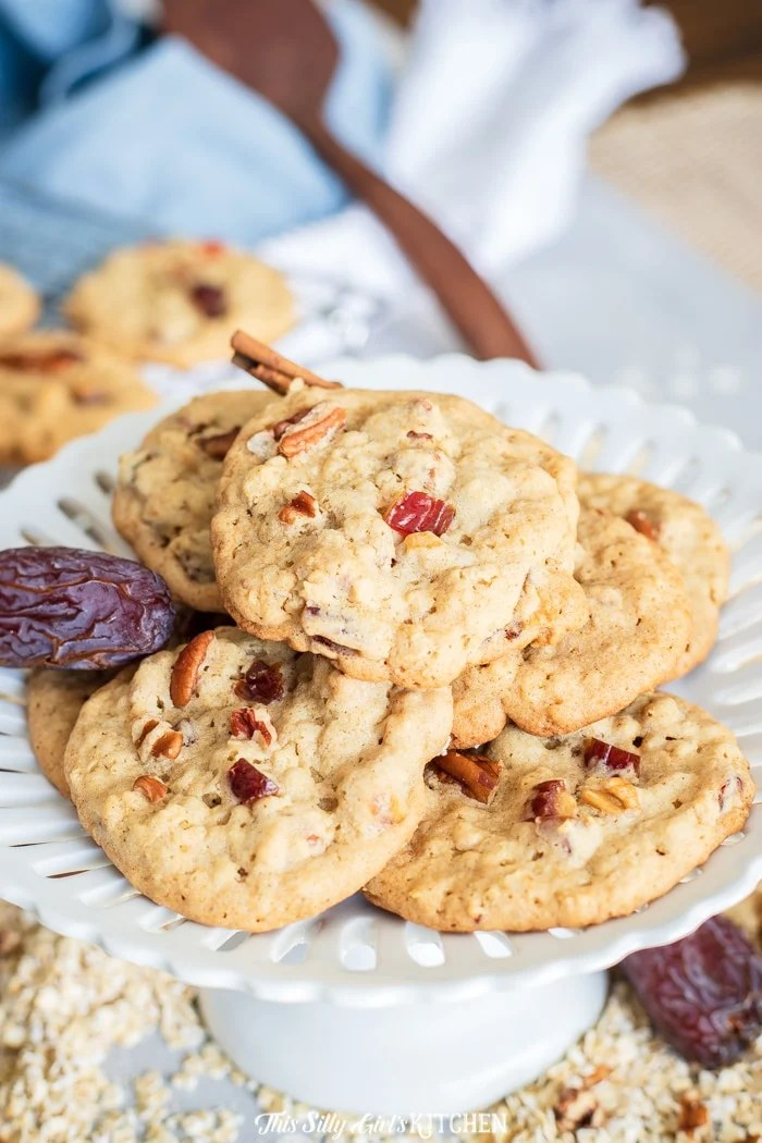 Date Cookies, soft and chewy cookies made with oatmeal, chopped dates, pecans, and a touch of cinnamon. #recipe from thissillygirlskitchen.com #cookies #datecookies #oatmealcookies