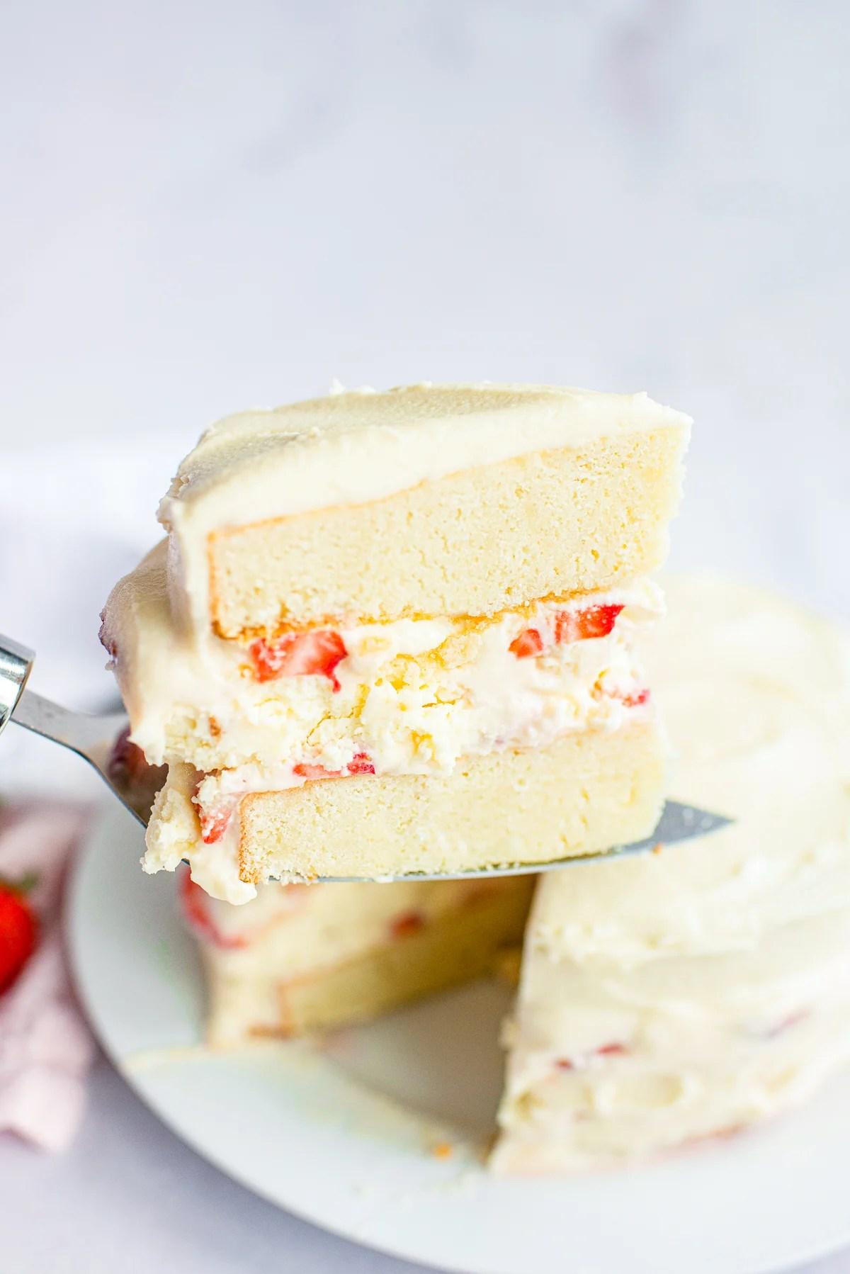 Cake server lifting up a slice of Cheesecake Cake