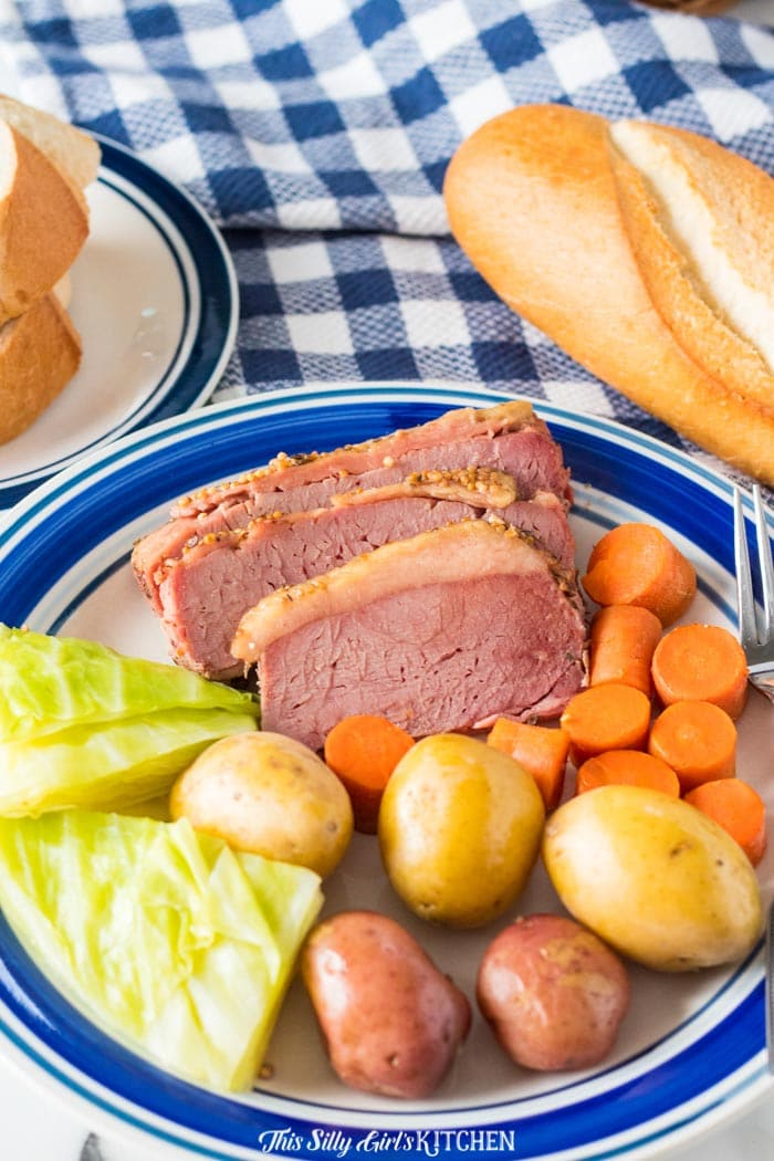 Close up of plated Slow Cooker Corned Beef Dinner with bread