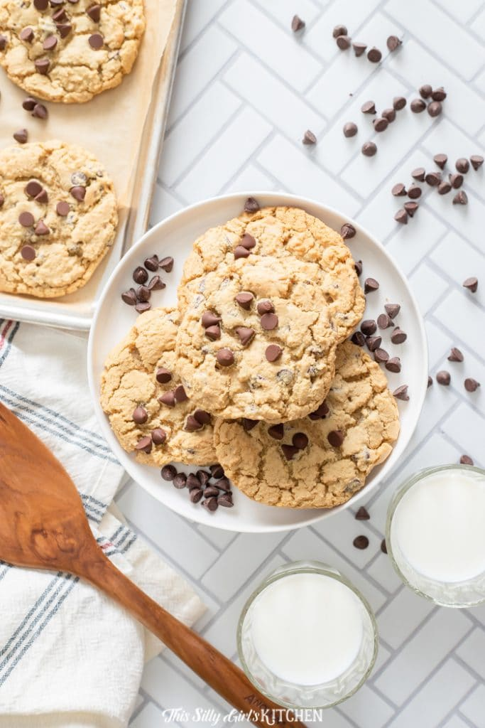 overhead shot of cookies on a plate with milk and spatula