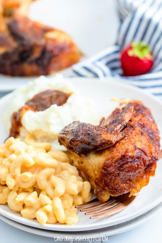 rotisserie chicken on plate with sides
