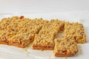 Close up of just cut peach crumble bars