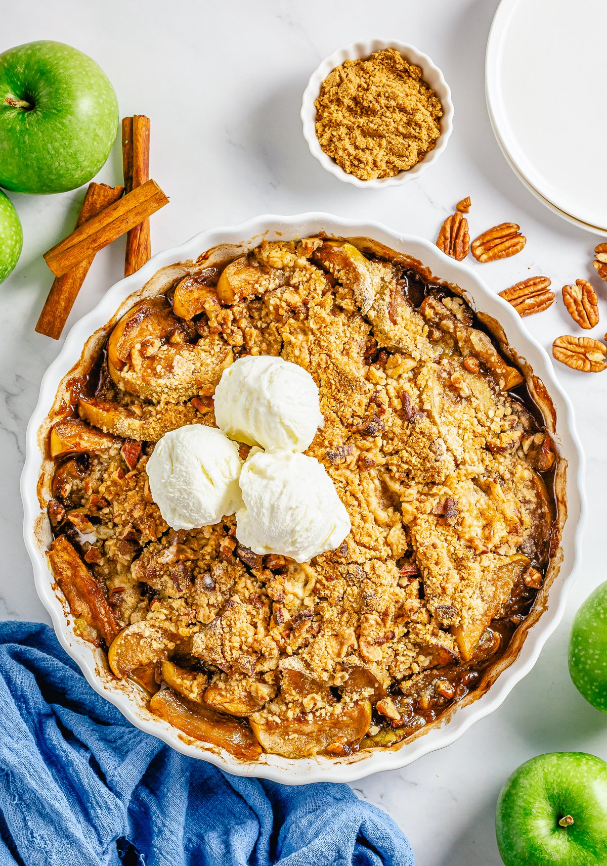 Easy Apple Crumble out of oven in baking dish topped with ice cream.