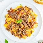Overhead of short ribs over pasta square image