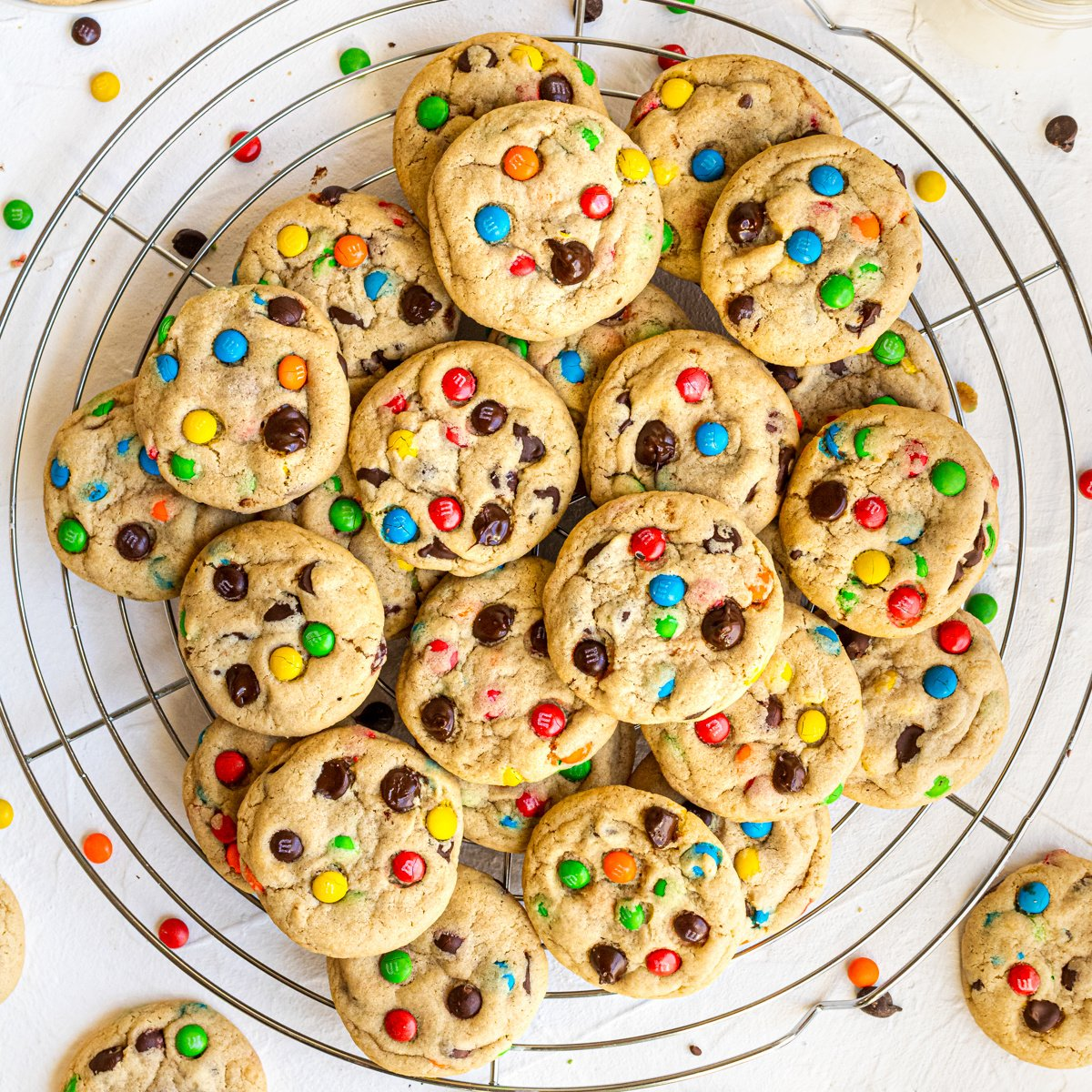 Overhead of finished cookies on round wire rack stacked square image