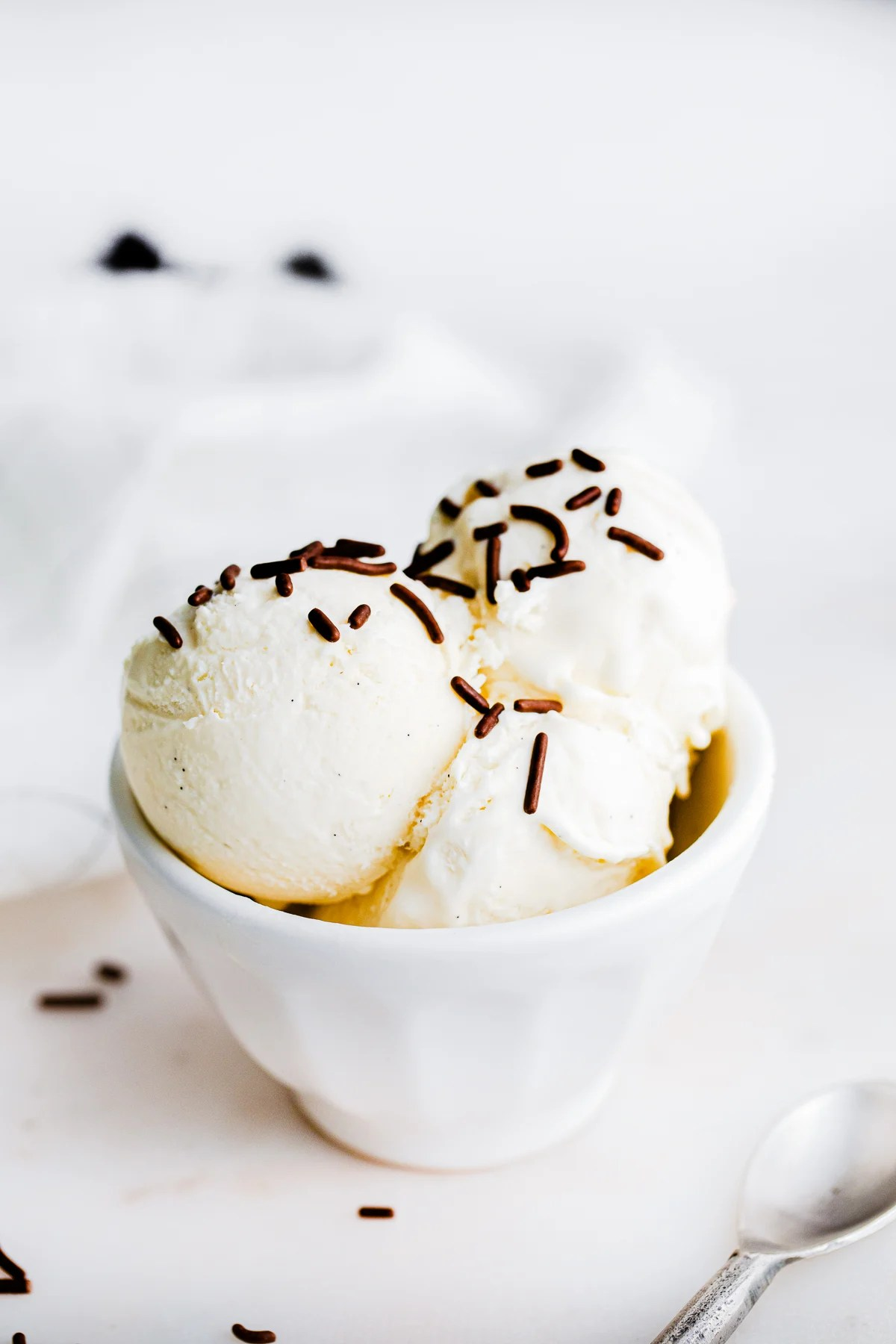 Ice cream in white bowl with chocolate sprinkles