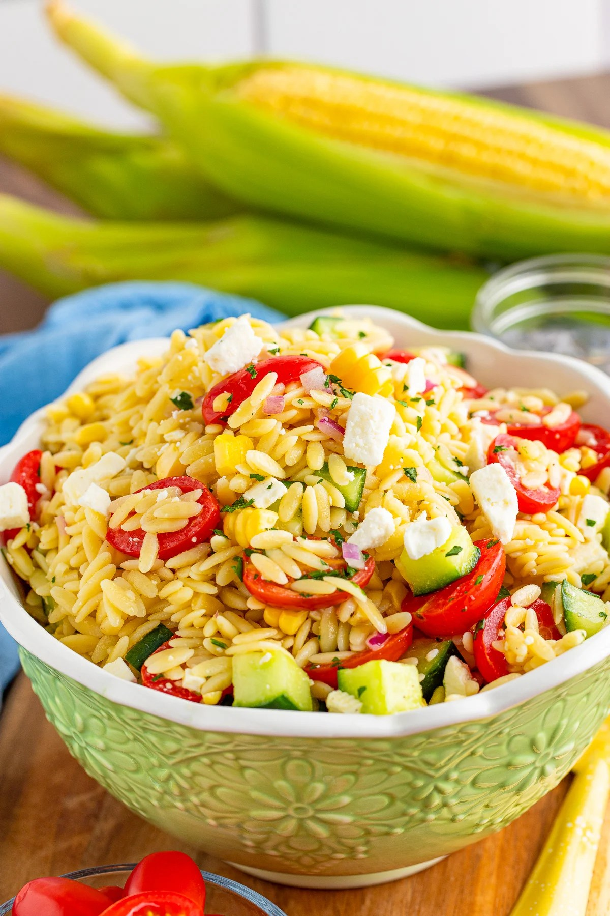 Green serving bowl with Orzo Pasta Salad